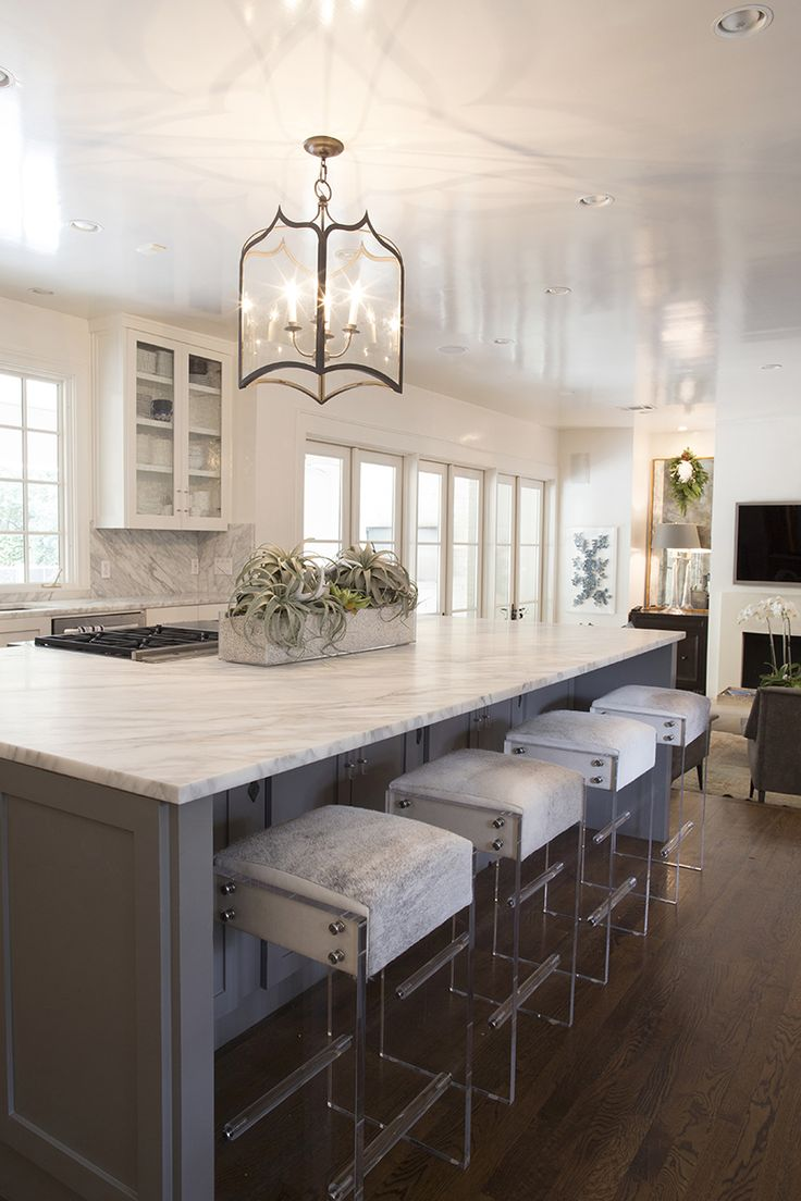 lucite acrylic bar stools are the perfect complement for this kitchen island