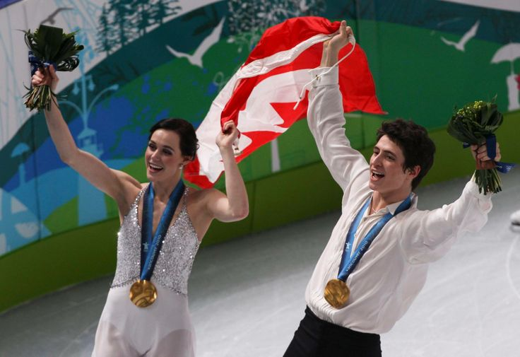 Tessa Virtue and Scott Moir with Gold Medal in Vancouver 2010 Games.