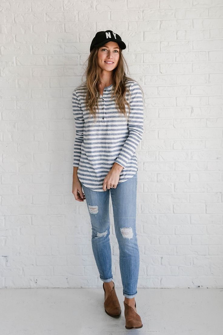 DETAILS: - Striped long sleeve top with round neckline - Half buttoned down and a curved hem - Fabric Content: 100% COTTON - Model is wearing a small - Paired with Crystal Cove Jeans