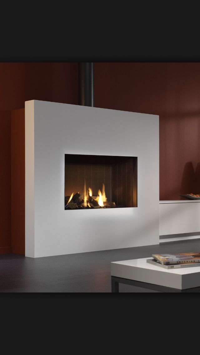 If you're going to go modern,  go very clean and high contrast.   The burning fireplace is not enough to (psychologically)  warm the room,  but it does serve as a point of interest.