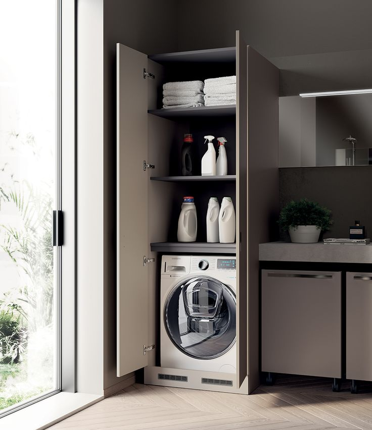 Tall washing machine unit, featuring compartments for rational use of space and materials