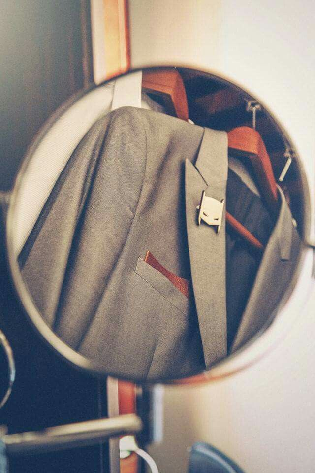Suit jacket with leather pocket square and wooden Batman boutineer
