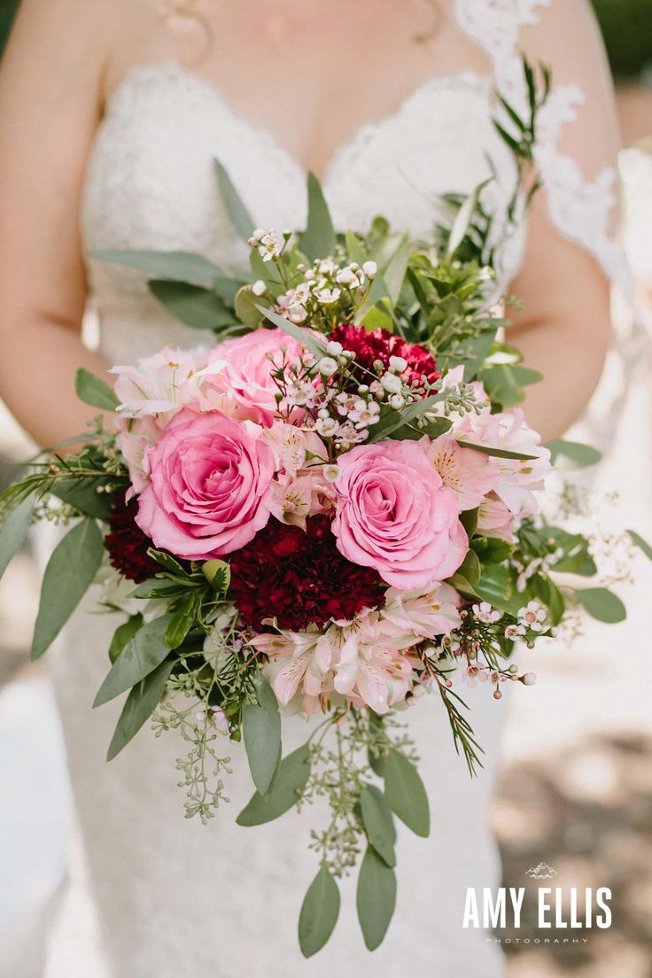 Deep burgundy carnations really make these soft-pink roses POP in this shabby-chic wedding bouquet! Pink alstroemeria, waxflower, and seeded eucalyptus round it out for a free-spirit feeling.   Photo courtesy of www.amyellisphotos.com