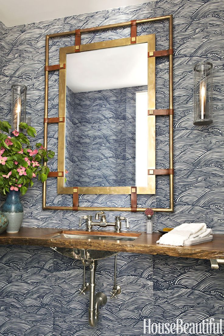 Powder Room  The powder room's vanity has a custom walnut counter and a Lucca Home mirror; wallpaper, Adrienne Neff.