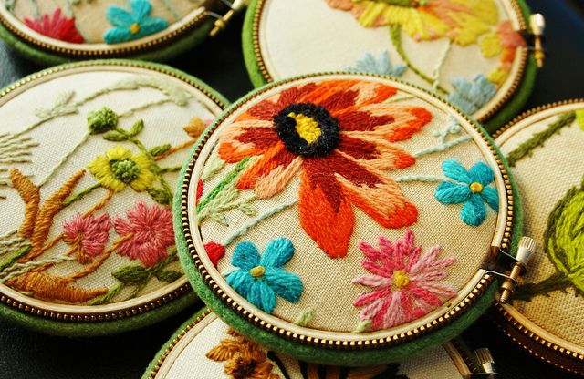 vintage crewel pincushions  Sections of vintage crewel work stretched into embroidery hoop... finished off with a wool backing and stuffed with poly fill.