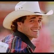 Luke Perry as Lane Frost in 8 Seconds