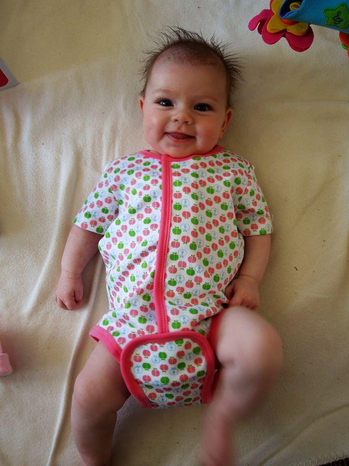 Beautiful Brooke wearing her Magnificent Baby Apples Onesie