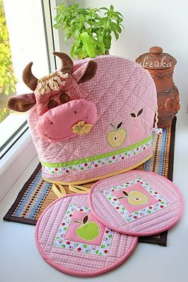 Idea - set of pink potholders and hot water bottle on cow Maker