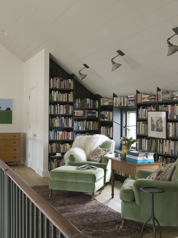 Oyster Bay Beach House interior designed by Heide Hendricks - This cozy book nook has a great variety of lighting, and I think it would be particularly enjoyable during the dark days of winter.