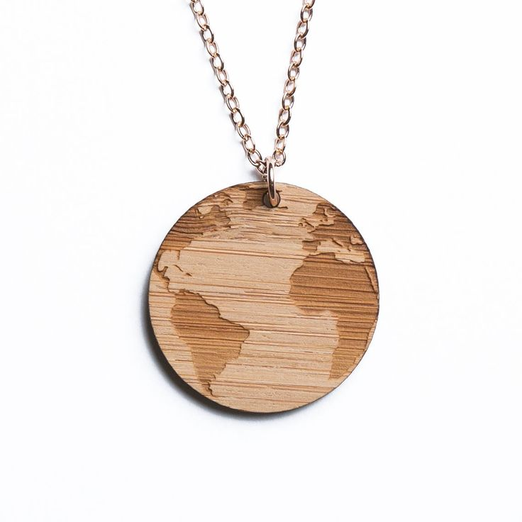 America, Africa, and Atlantic Ocean map necklace, etched into eco-friendly FSC certified bamboo (using a laser burner), on a recycled rose gold plated sterling silver chain.