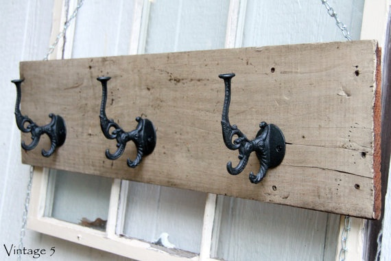 """This one of a kind wall rack is made from wood that was reclaimed from a train station in LaGrange, GA! It has been cleaned and sealed to protect all the years of wear! It measures 9"""" x 37 1/2"""", comes ready to hang on the wall, and has 3 black hooks perfect for hats, jackets, umbrellas, or jewelry. This rack would be a great addition to any room and is sure to grab attention!"""