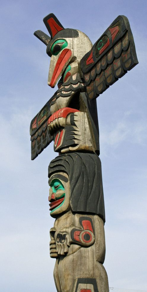 "This totem pole was meant as a thank you from one chief to another. Raven perches on top and delivers the pole. Eagle is under Raven and represents the power of the chief, a member of the Eagle Clan. The chief's son is next. His open hand symbolizes ""thank you."" Raven, like Coyote of the Southwest, is a trickster. Both are among my favorite mythological animals."
