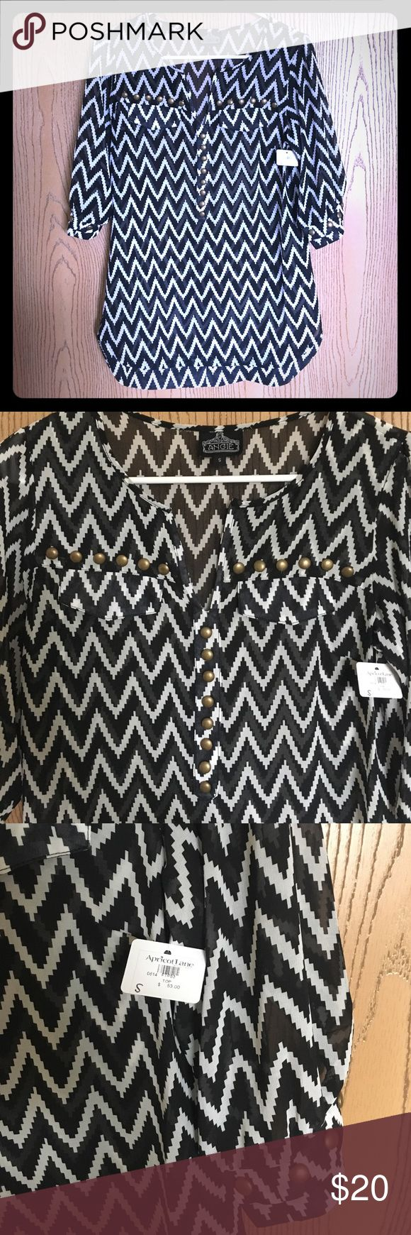 Apricot Lane boutique-Chevron 3/4 sleeve Black/white chevron 3/4 sleeve. Gold embellishments on front and sleeves. Small slit neckline. Back of sleeve with cute design! Angie Tops Blouses