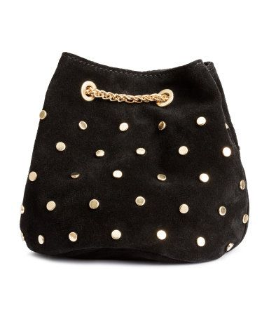 Small black bucket bag in 100% suede with round gold-tone studs, a metal chain shoulder strap, and snap fastener. Fabric lining. | H&M Accessories