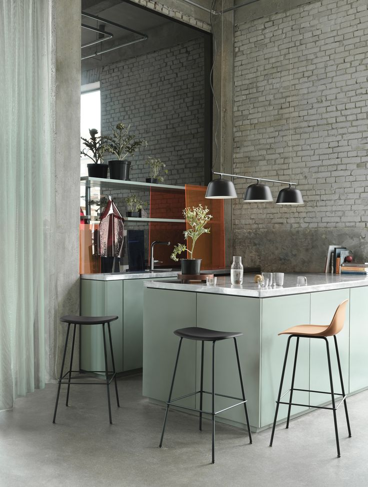 Scandinavian kitchen settings with the Fiber Bar Stool and Ambit Rail Lamp.