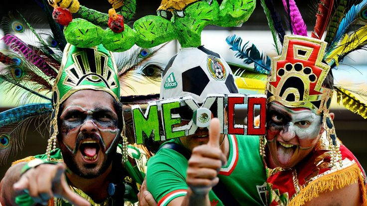 Fans of Mexico pose prior to the 2014 FIFA World Cup Brazil Group A match between Croatia and Mexico