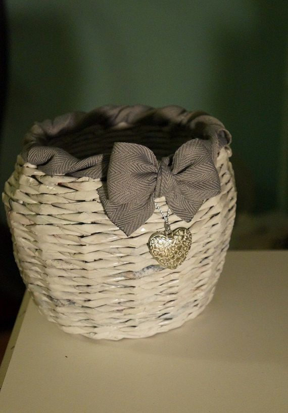 Decorative paper basket with a ribbon s