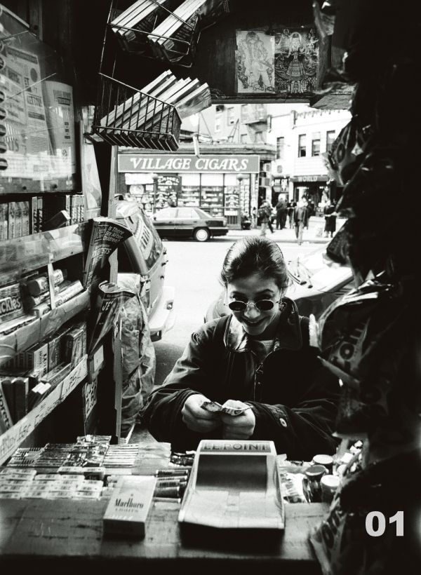 "We are looking for you in the photographs of ""Rao's Newsstand""   NYC 1996-2004. You might be in the photos. This is a project to find people and listen to their life story.  https://www.busmetoo.com/?page_id=4742"