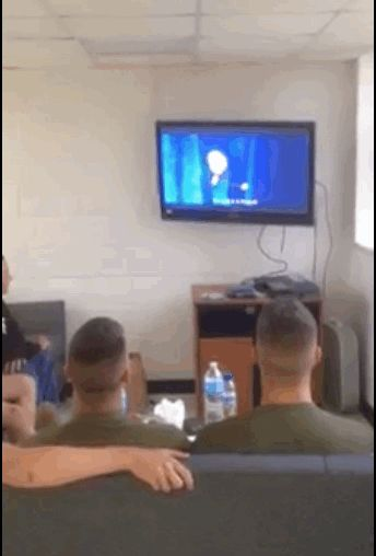 Awe this is so sweat! These marines watching frozen and singing let