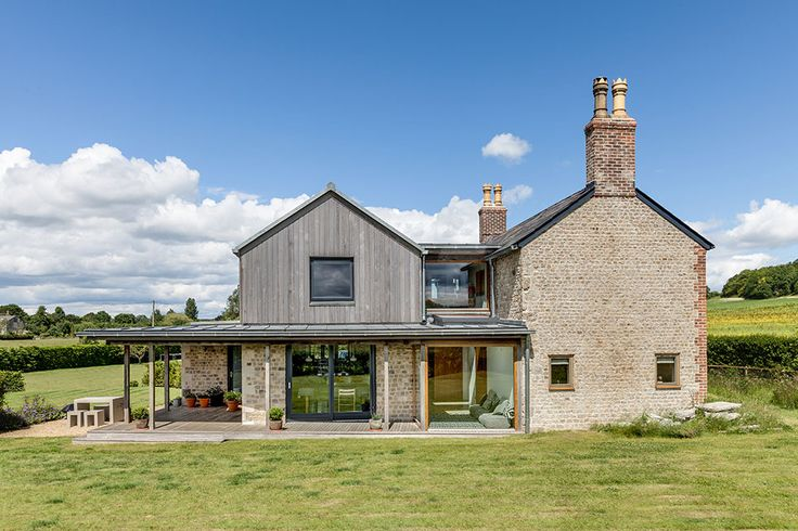 Interesting timber clad extension to an existing brick / stone house