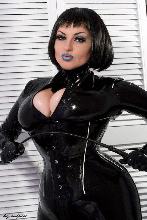 Mature dominatrix in leather smoking