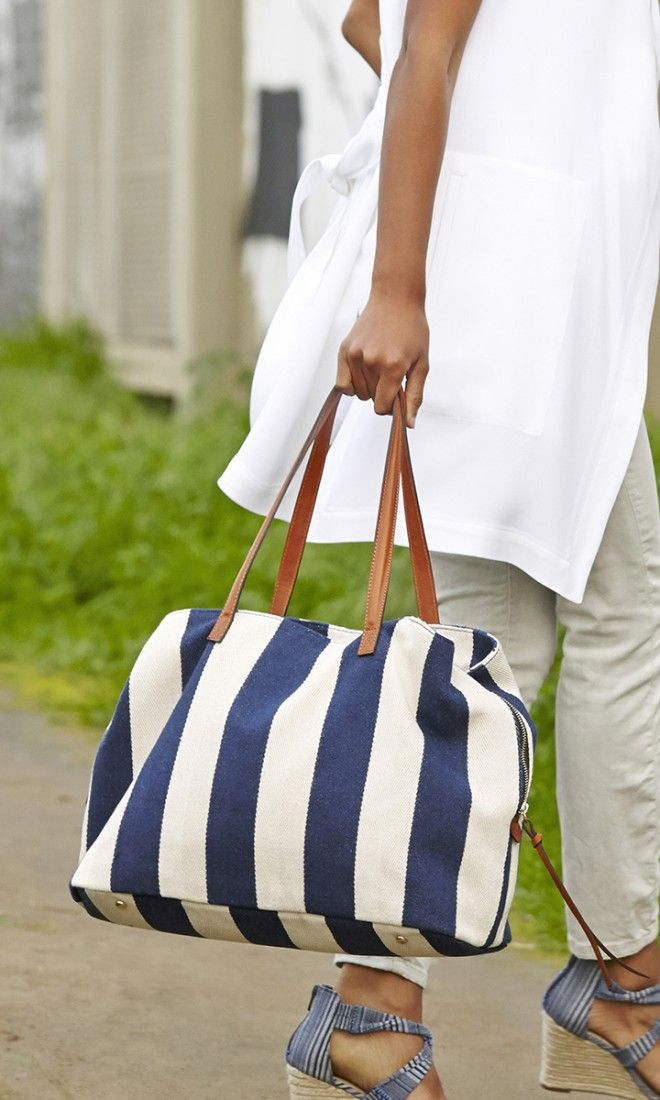 Oversized navy & cream striped tote bag with shoulder straps, top zipper closure and three inside sections