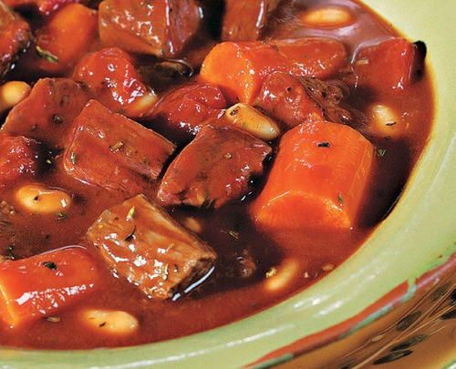 Transport yourself to Italy with this slow cooker beef stew recipe. Chunks of beef and carrots cook in savory tomato soup, beef broth, and red wine.