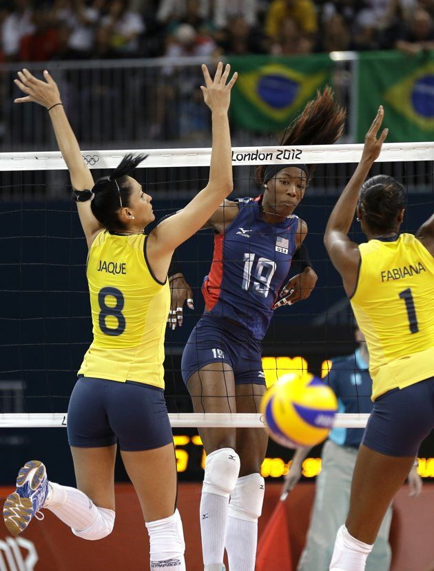 Brazilian women's volleyball team take gold - USA's Destinee Hooker (19) watches her spike get past Brazil's Jaqueline Carvalho (8) and Fabiana Claudino (1) during a women's volleyball gold medal match at the 2012 Summer Olympics Saturday, Aug. 11, 2012, in London. (AP Photo/Chris O'Meara)