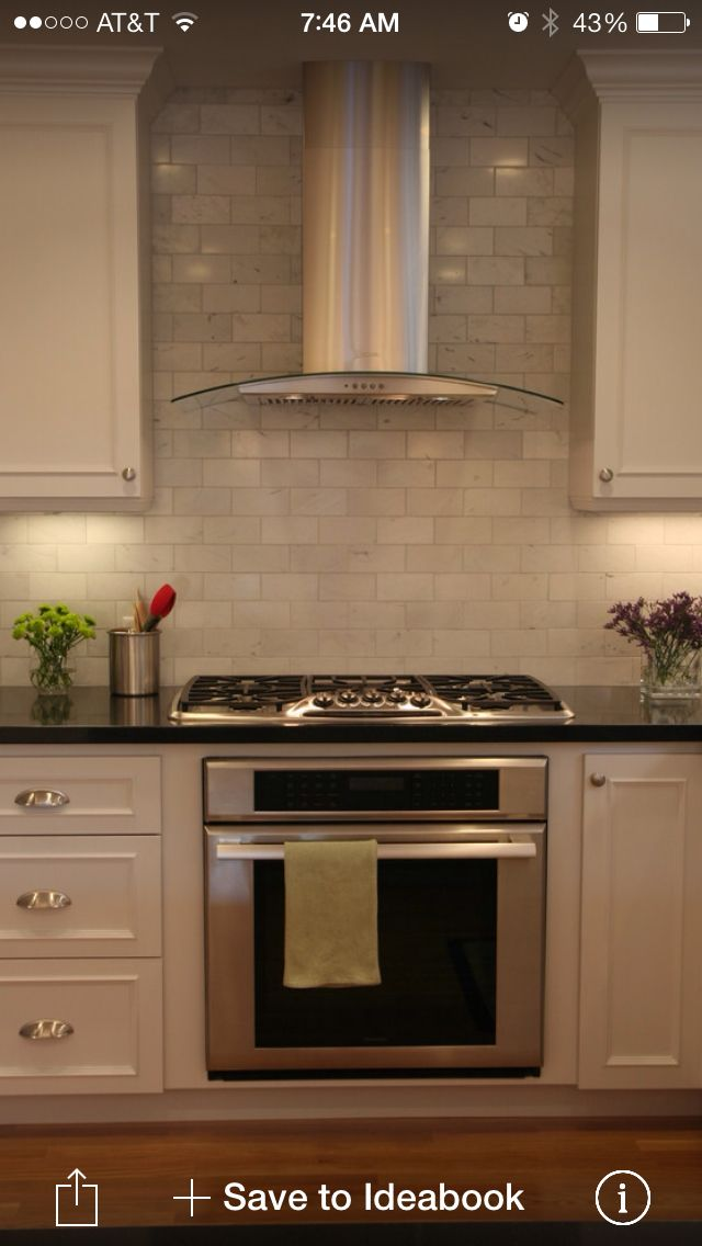 Tile all the way up around range. Hood like this.
