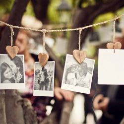 I wish i could hang pictures on a string like that in my house and have it not look silly. It only works or looks good for a wedding or a party
