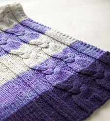 This FREE pattern is great for a beginner who wants to explore cables and switching yarn colors.  It's a baby blanket, but easily convertable to a larger size.  How to Knit a Cabled Blanket—The Idiot's Quick Guide