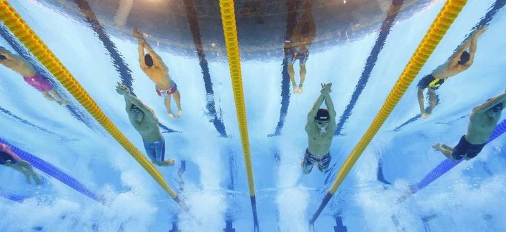 United States' Chase Kalisz, center left, and Japan's Daiya Seto, center right, compete in the final of the men's 400-meter individual medley…