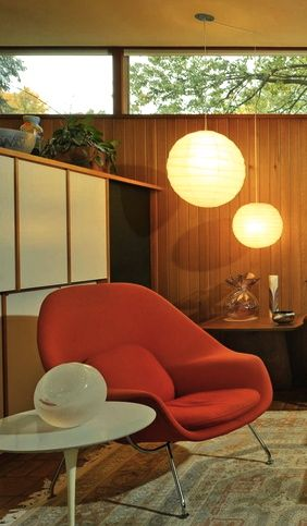 womb chair, gorgeous wood panelling, clerestory windows, cluster of simple pendant lights... forms the perfect mid-century modern very cozy and livable interior. What's not to love?