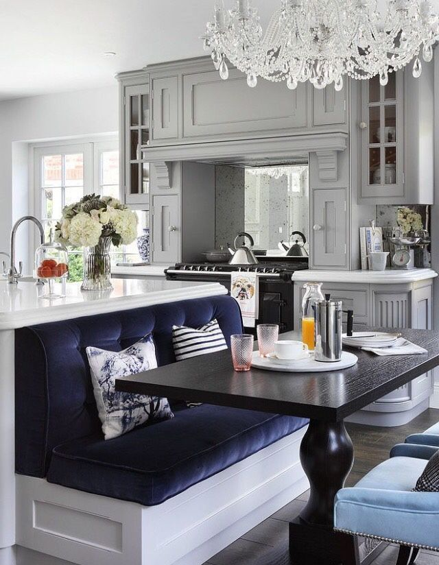 Really like the bench built into the kitchen island - I bet the seat could have tons of storage capacity as well.