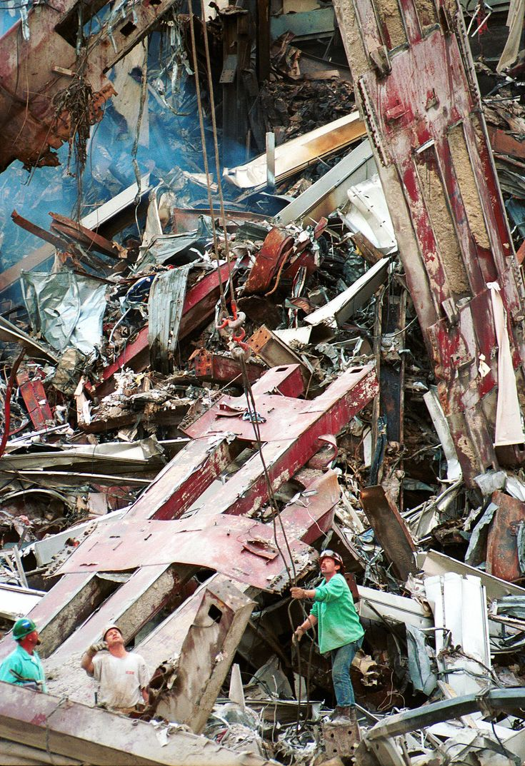 Rescue workers sift through the wreckage of the World Trade Center in New York City, two days after the September 11, 2001 terrorist attack.