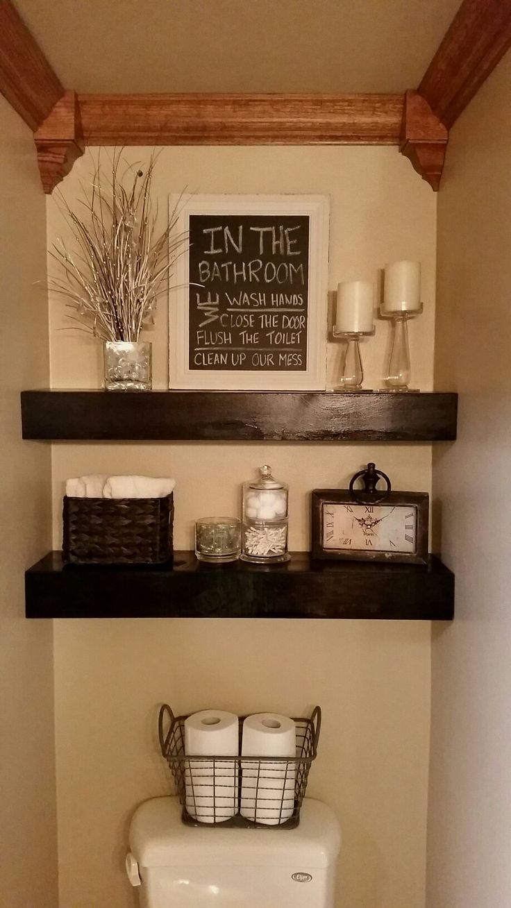 The result of Pinterest inspiration!  This is my bathroom with DIY floating shelves.  Turned out beautifully.  I love it! I bought the lumber from Lowes and stained the shelves a dark walnut color.  Decor is from Michaels, Target, and Hobby Lobby.  Fun project.