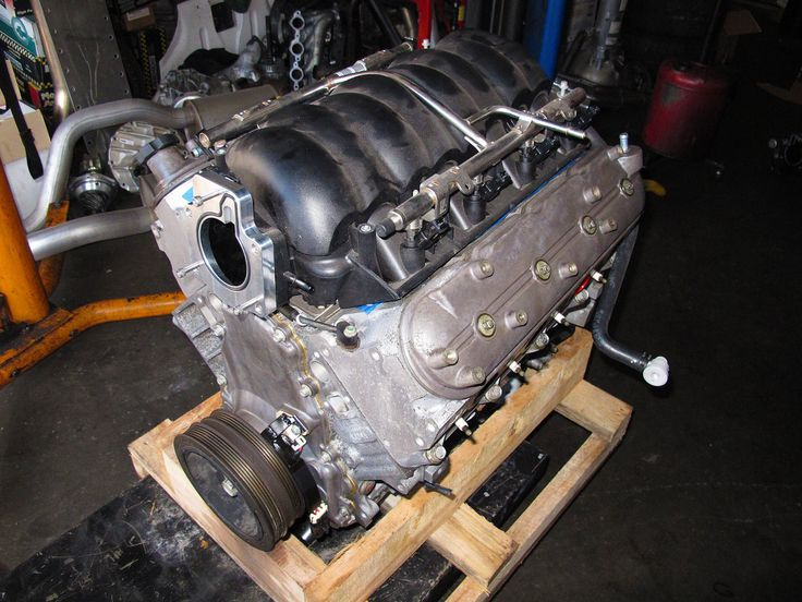 Our salvage L92 came from a 2010 Escalade that had been wrecked in a rollover accident. We picked it up for $2,500 with the factory truck intake still on it. We swapped that out for a factory LS3 intake that would work in the C4 for hood clearance.