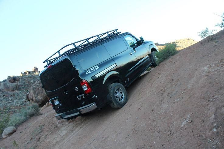 Nissan Nv 4x4 Converted By Advanced 4x4 With An Aluminess Roof Rack Showing What It Can Do Nissan 4x4 Nissan Vans 4x4 Van