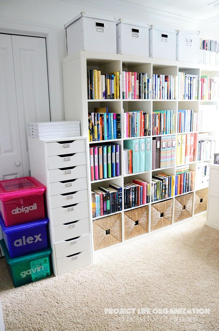 Organize your books, supplies and odds and ends with the IKEA Expedit system. It's an attractive, inexpensive and effective way to organize a large collection! Via A Bowl Full of Lemons
