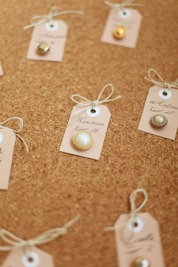 pearl button (or vintage clip-on earrings) escort cards