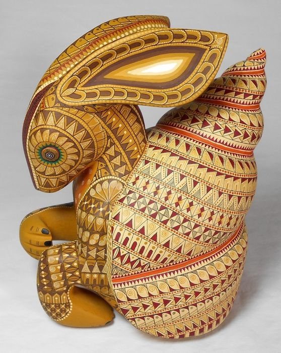 Solmar Imports - Mata Ortiz, Juan Quezada, Casas Grandes Pottery and Oaxacan Wood Carvings - Alebrijes, Oaxacan Animals...interesting bunny with a snail shell