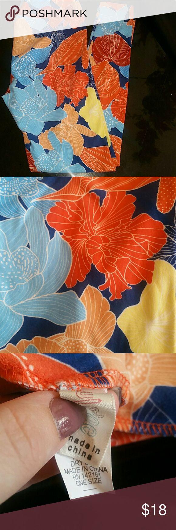 Ladies Leggings Brand new Ladies LuLaRoe leggings.  One size.  Floral print.  Navy background.  Washed once. LuLaRoe Pants Leggings