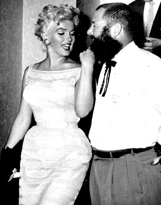 """alwaysmarilynmonroe: """" """"Marilyn judges a Beard Contest in August 1955. """" """" Photography by Eve Arnold"""