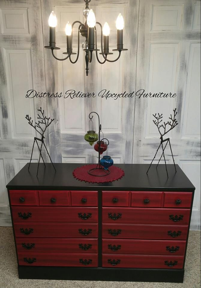 Nicole Kenehan refinished this festive dresser using Lamp Black Milk Paint for the base and Holiday Red Milk Paint topped with Pitch Black Glaze Effects for the front. The entire piece was sealed with High Performance Top Coat flat.