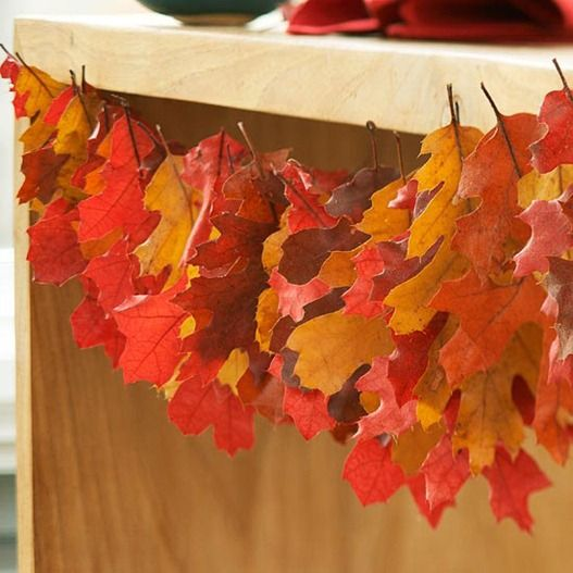 Spray adhesive, cardstock, and ribbon are all the supplies you'll need to transform fallen leaves into ornaments for display on branches around your home.