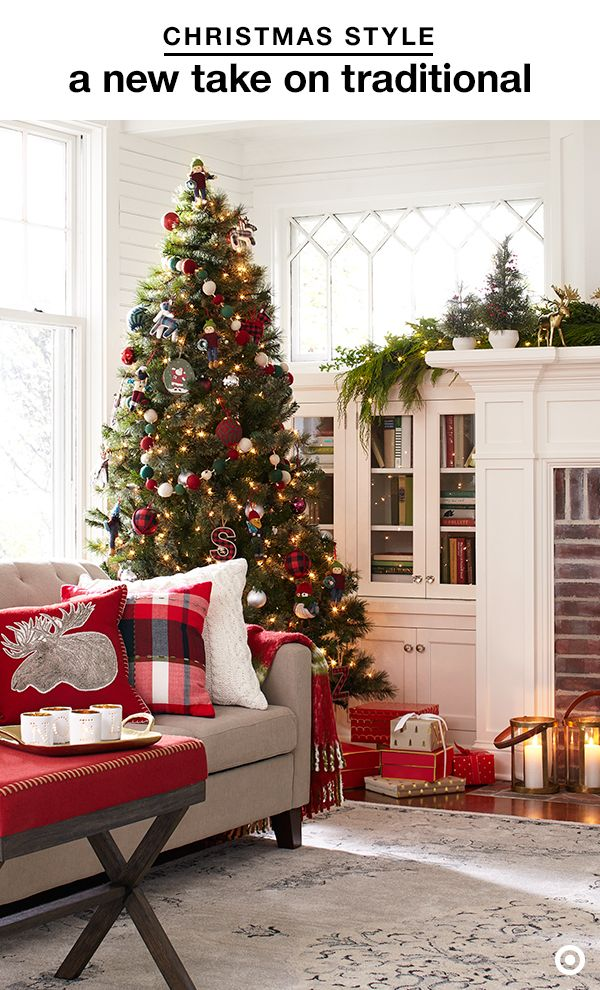 Step up your Christmas decor game by mixing in a few charmingly classic elements. Soft textures, like throw pillows and faux-fur throws, keep the living room cozy, while pops of blue in the plaid pillow and ornaments on the tree are an unexpected touch that keeps traditional feeling fresh and new. Don't forget to mix fresh and faux greenery for a fragrant (and lasting) festive feel.