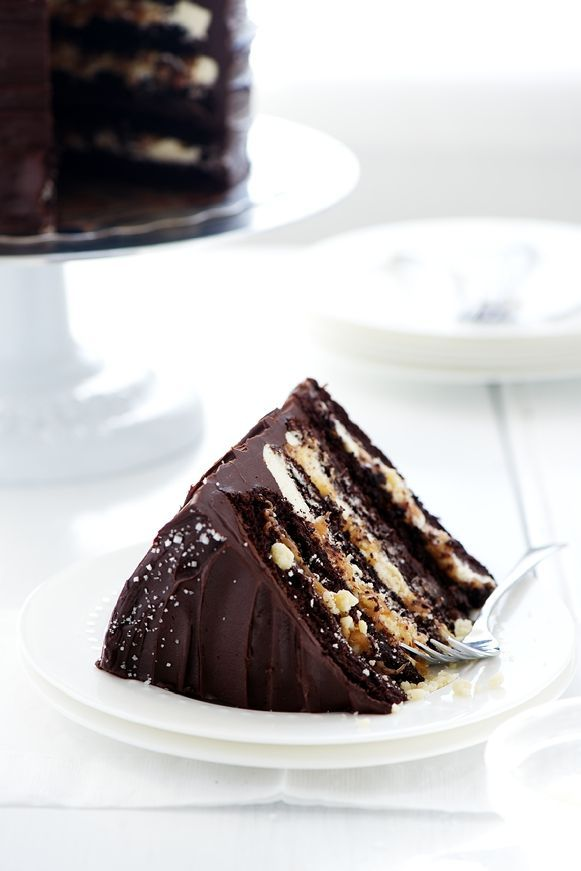 Millionaire's Layer Cake (Sweetapolita). A dark moist chocolate cake filled with satiny vanilla bean buttercream, homemade salted caramel, buttery shortbread crumble, dark chocolate ganache and frosted with more ganache and a sprinkling of sea salt.