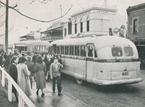 Busy bus terminal, Morwell, 1955
