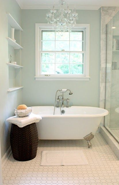 great use of small space in a bathroom. There is a tub, shower, and smaller built-ins downstairs?