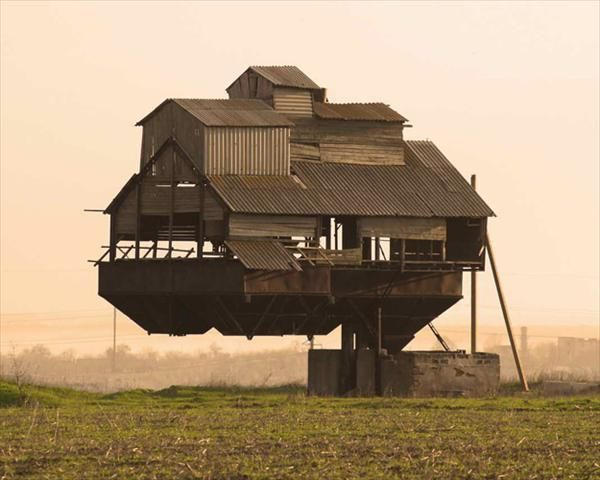 Floating Castle, Ukraine. Supported by a single cantilever, it's claimed to be an old bunker for the overload of mineral fertilizers...